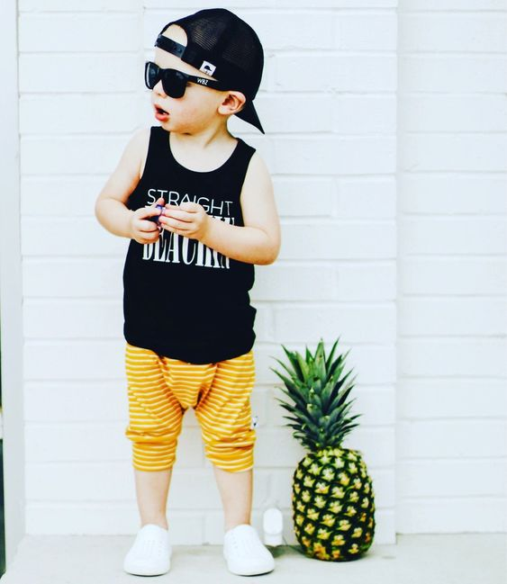 fashionable toddler boy in tropical style outfits