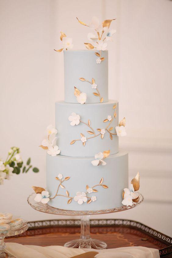 gorgeous dusty blue tropical wedding cake