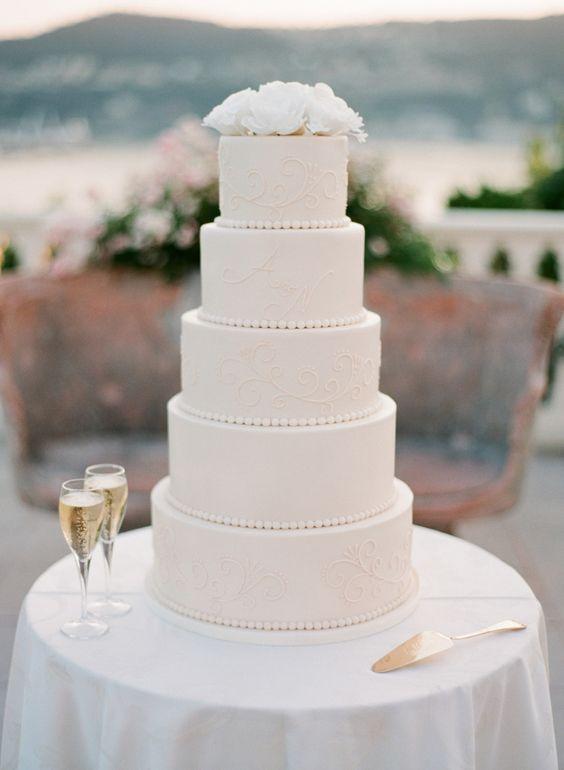 elegant white beach wedding cake idea